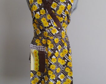 Woman's Cross-breast Brown ruffle apron with yellow flowers.