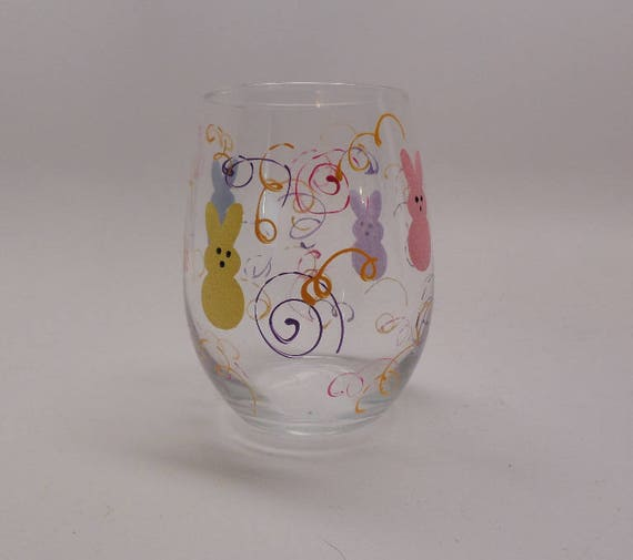 Hand Painted Bunny Stemless Wine Glass for Easter surrounded by bunnies and swirls