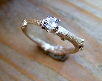 budding twig sterling silver ring with round diamond cut topaz. Contemporary engagement ring