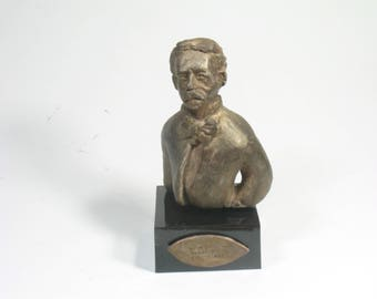 Denslow, W.W. DENSLOW  - Illustrator of Oz.  Hydrostone with bronze patina
