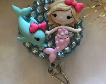 Adorbs! Baby mermaid with dolphin friend badge reel