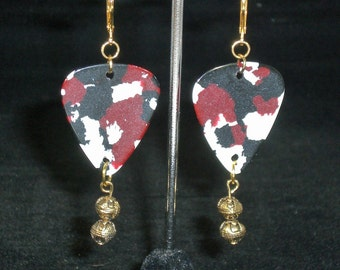 Earrings, dangle, cow print guitar pick with gold accent beads