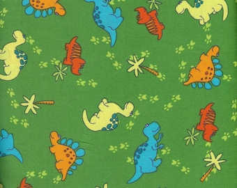 Dinos on Green 100% cotton fabric- sold by ( multiple lengths)  #11