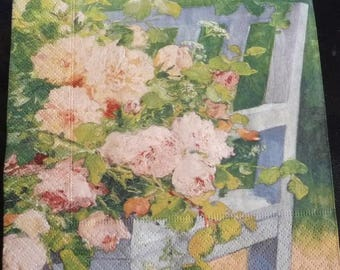 Bouquet of roses on a bench napkin
