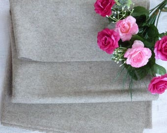 FABRIC HAS LINEN COLOR WOOL BASE