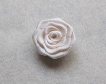 Ivory flower lapel pin