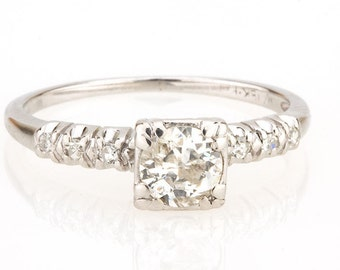 Diamond Solitaire Engagement Ring in 18K White Gold With 0.56 CTW Round Cut Diamond Solitaire And Accent Diamonds