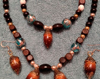 Beautiful one-of-a kind Costume Silver and Gold jewelry made from organic items such as pinecones and berries.
