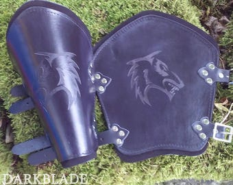 A Pair of Black Engraved Leather Vambraces suitable for Larp, Cosplay and Costume. Tribal Wolf