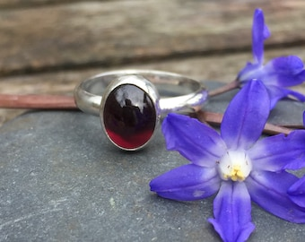 Silver ring with Garnet cabochon