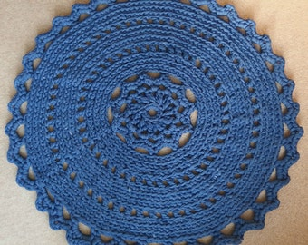 Rounded rug crochet off t-shirt yarn, in the colour jeans blue.