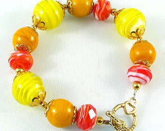 Yellow, Orange, Red Glass lampwork bead bracelet 8 inches, with gold color finding, bright cheerful happy colors
