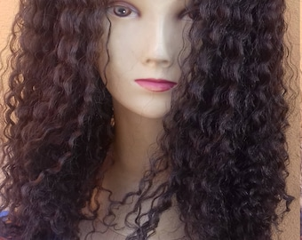 Curly heat resistant synthetic wig.
