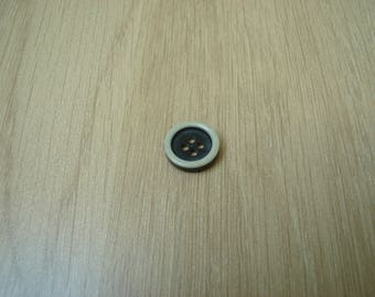 White and blue button with RIM