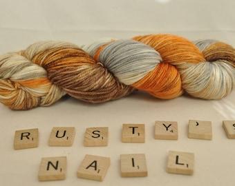 "Hand-dyed yarn, ""Rusty's Nail"" variegated, soft and squishy yarn. Great for socks or shawls. 80/20 Superwash wool/Nylon"