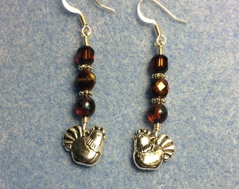 Silver chicken charm dangle earrings adorned with brown Czech glass beads.