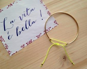 Bangle is plated 14 k - neon yellow cord