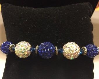 Bracelet with blue and white beads, and various spacers.