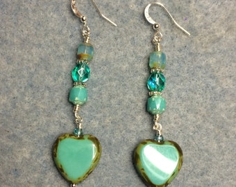 Opaque turquoise Czech glass heart bead dangle earrings adorned with turquoise Czech glass beads.