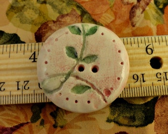 133: Large Ceramic Button In Soft Pink With Green Leaves
