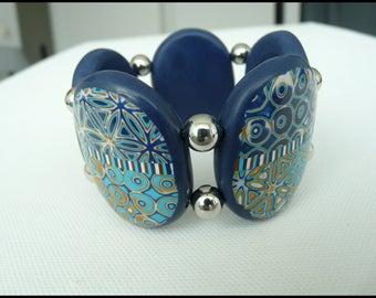 Blue and gold elastic bracelet