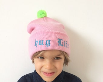 HUG LIFE Kids Hat Childrens Cap with Pom Pom in Acrylic One Size 2 Years Plus Unisex