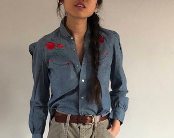 80s Ralph Lauren denim shirt / puff sleeve blouse / snap front denim shirt / vintage western shirt | xs