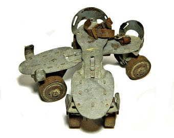 A Pair of Old Union Hardware Metal Roller Skates