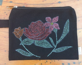 Puff painted flower pouch