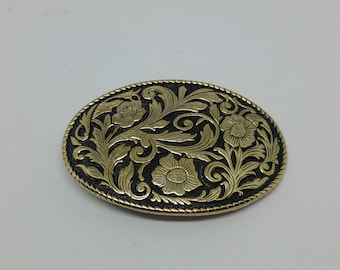 Oval brass flower buckle