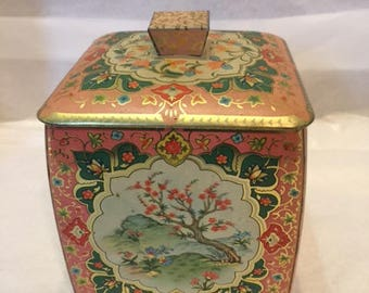 Pink and gold metal tin by The Metal Box Company