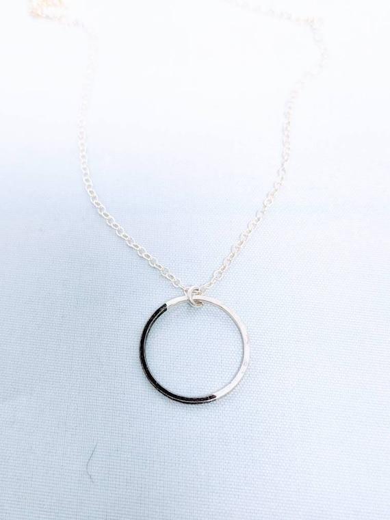 Black and silver circle pendant