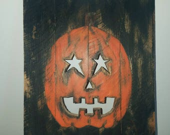 Halloween jack-o-lantern decorative plaque