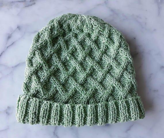 Aran knit beanie: original design handknit in green sparkly yarn. Made in Ireland. Cable knit beanie for her. Irish knit beanie. Aran hat.