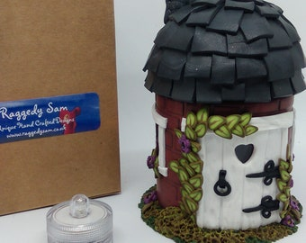 Handmade Fairy house with purple flowers and LED light