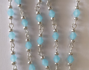 chain 55cm / 4mm light blue opaque glass bicone beads