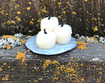 Three white candles on silver tray made of polymer clay
