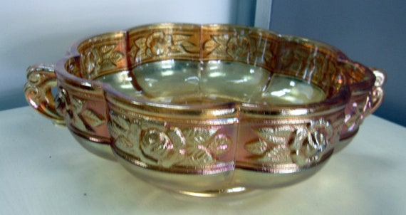 Peach Carnival Glass serving bowl with handles