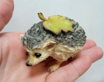 Hedgehog with a leaf wood carving