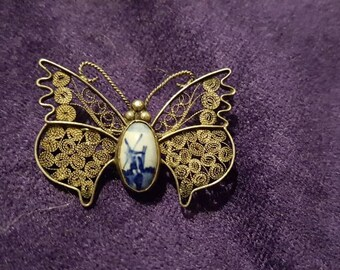 Sweet Vintage silver filigree Butterfly brooch with Delft Windmill scene.