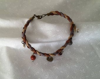 A faux suede braided and beaded bracelet