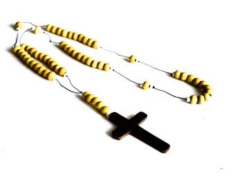 Wooden necklace with cream beads and a cross pendant