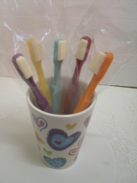 Half a dozen adult size chocolate toothbrushes