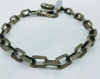 Sterling silver chain bracelet with greek key design and details