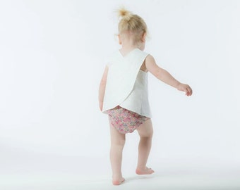 Baby girls white Cross over back pinafore top