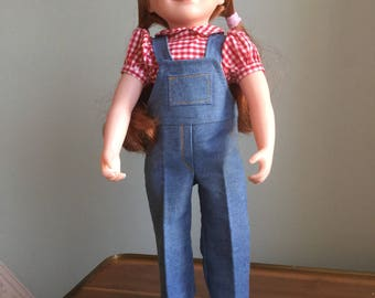 Farm girl outfit of denim overalls and traditional gingham blouse. Perfect play outfit for spring and summer. Fully washable.
