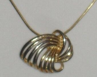 Beautiful gold-tone swirl knot pendant