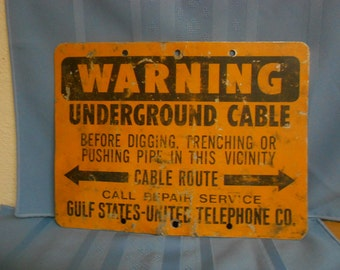 1960's WARNING UNDERGROUND CABLE / Gulf States-United Telephone Co Medal Sign