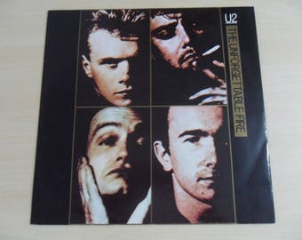 "12"" U2 The Unforgettable Fire 12 IS 220 Bono The Edge Clayton"