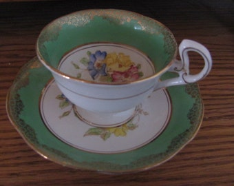 Royal Mayfair Bone China cup and saucer Green & White with floral and Gold trim, numbered, England